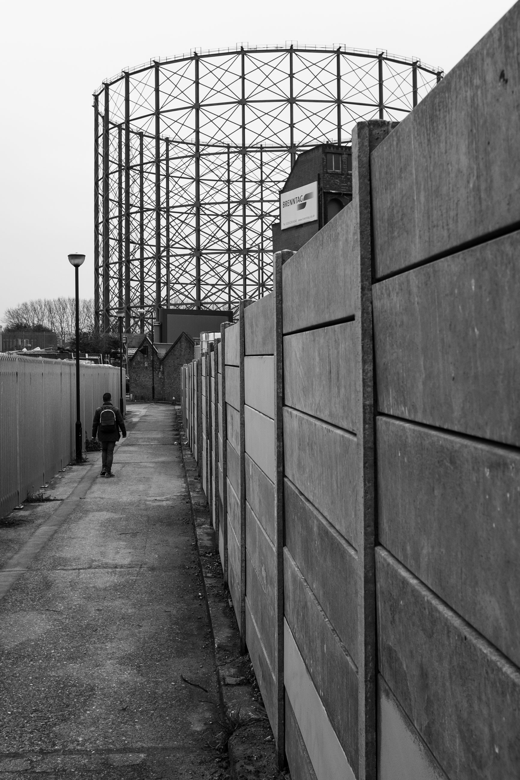 architecture, built structure, real people, full length, one person, day, men, lifestyles, walking, outdoors, building exterior, the way forward, nature, sky, rear view, leisure activity, footpath, direction, wall - building feature