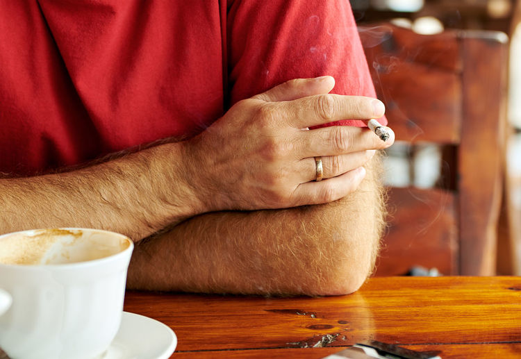 Cigarette  Close-up Coffee Focus On Foreground Lifestyles Person Red Smoking Spirituality