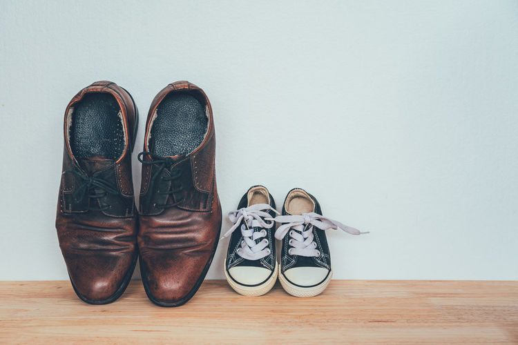 High angle view of shoes on hardwood floor against white background