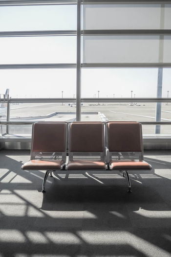 wait area in airport Absence Airport Airport Departure Area Airport Terminal Chair Day Empty Glass - Material Indoors  Journey Mode Of Transportation No People Seat Shadow Sunlight Transportation Travel Waiting Waiting Room Window
