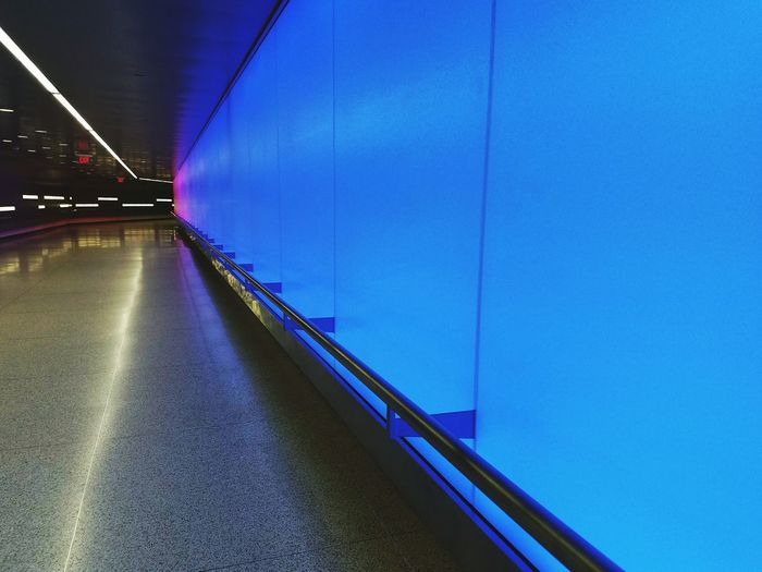 After long days at the hospital, I always welcomed this hallway of colored light. It leads to the parking garage. The colors change slowly with an ever growing gradient. This was our last day there and the blue color washed over me and my joy. It was very uplifting. Life Is Precious All Is Well Hallway Cleveland Clinic Hospital Hallway Blue Blue Wave 💙 Bridge - Man Made Structure Hallways Railing Exit Perspective Light Up My Life Vanishing Point Lines, Colors & Textures Illuminated Modern From My Point Of View Indoors  Light In The Darkness Color Colored Lights The Creative - 2018 EyeEm Awards