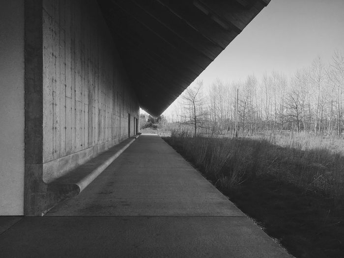 Leading lines Architecture Direction The Way Forward Built Structure Day Transportation 17.62° Diminishing Perspective Wall - Building Feature No People Sunlight Outdoors vanishing point Wall Road Sky Long Nature