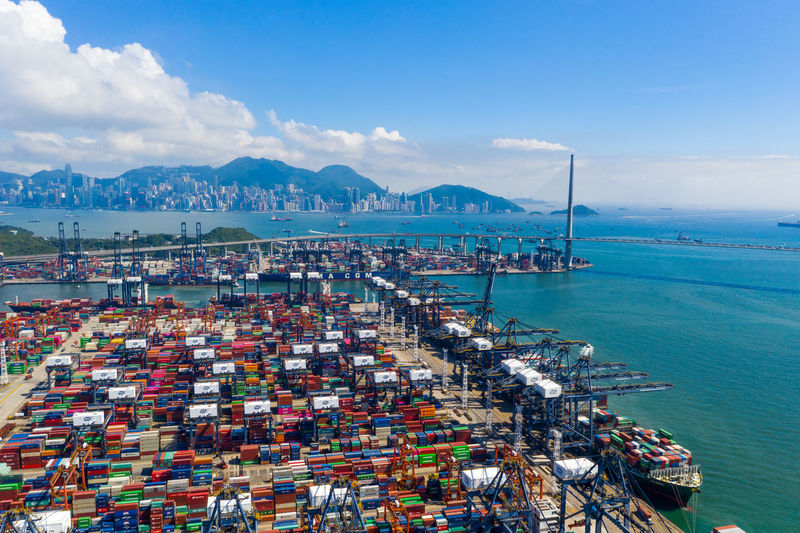 Hong Kong Terminal Cargo Kong Hong City View Port Trade China Container Marine Bridge Transport Industry ASIA Transportation Business Freight Sky Blue Goods Loading Industrial Building International Commercial Ship Dock Wharf Kwai Chung Kwai Chung Top Aerial Fly Drone  Over Above Down Top Down Panoramic Hk HongKong