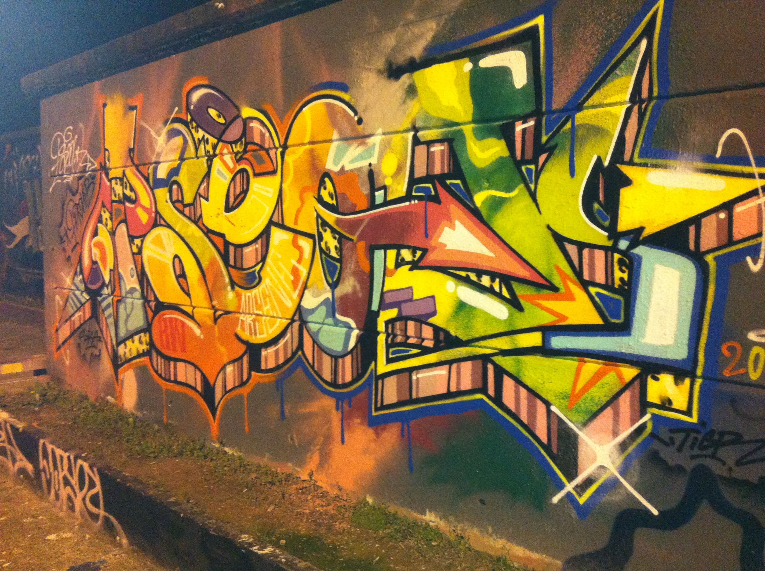graffiti, yellow, art, creativity, wall - building feature, built structure, art and craft, architecture, multi colored, street art, building exterior, text, outdoors, day, no people, transportation, sunlight, bicycle, wall, absence