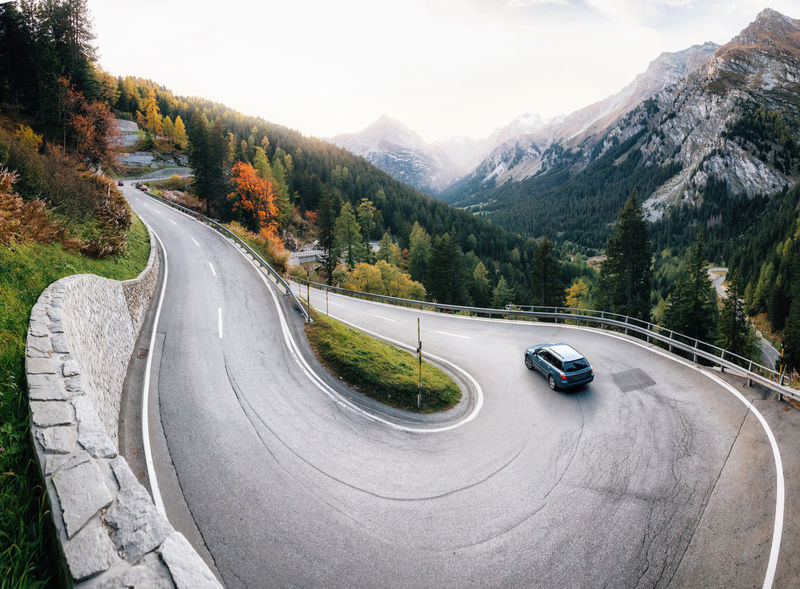 Adventure trip by car along winding mountain alpine road, Maloja Pass, Switzerland Alpine Alps Beauty In Nature Direction Land Vehicle Mode Of Transportation Motor Vehicle Mountain Mountain Range Mountain Road Outdoors Road Scenics - Nature Switzerland The Way Forward Transportation Winding Road