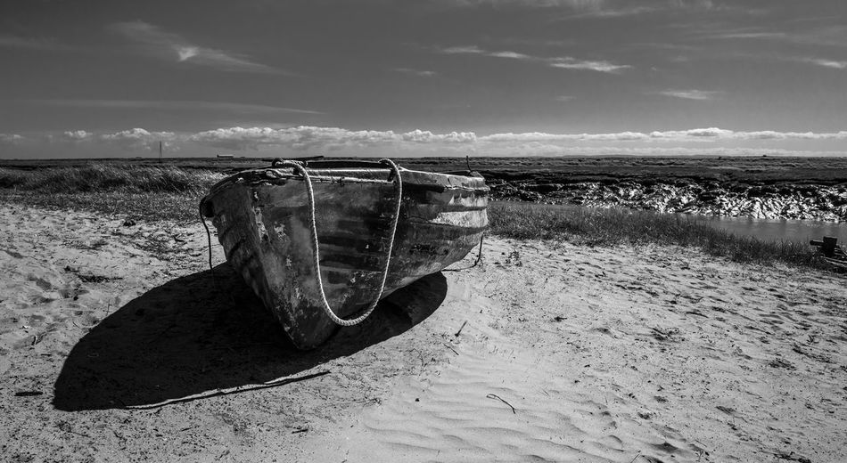 A small abandoned rowing boat on the beach at Uphill Marina, Weston-super-Mare, Somerset. Nature Somerset Weston-super-mare Beach Black And White Boat Coast Day Disguarded English Monochrome Nautical Vessel No People North Outdoors Reserve Sand Sea Shadow Tender Uk Unloved Unused Uphill Water