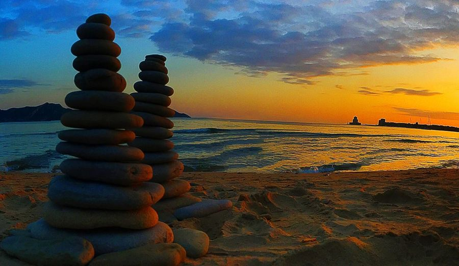 Sunset Sea Balance Rock - Object Beauty In Nature Beach Stability Nature Scenics Horizon Over Water Cloud - Sky
