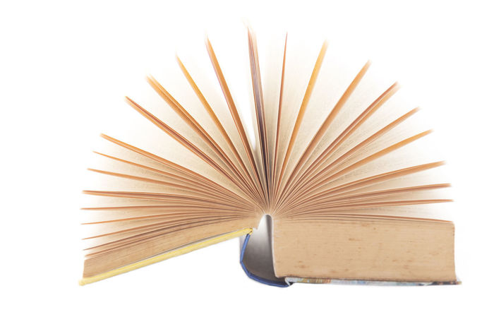 An Open Book Academics Books Bright EyeEmNewHere Pattern, Texture, Shape And Form Read Book Book Cover Brown Paper Close-up Cover No People Novel Open Book  Pages Pages Edges Pages Of A Book Pattern Product Product Photography Reading A Book Studio Shot Thick Books White White Background