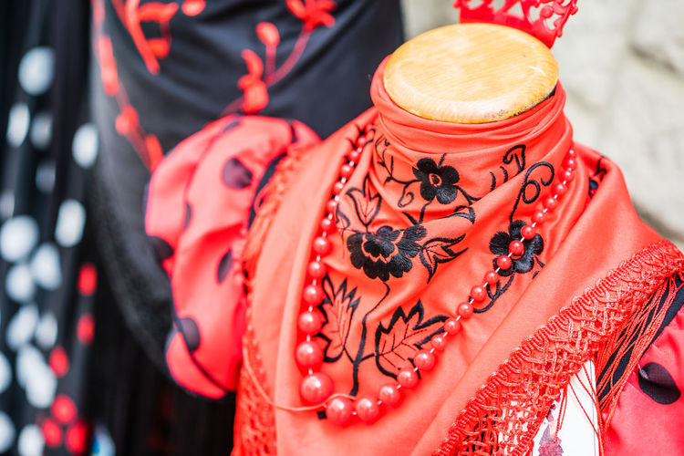 Close-up of garments with jewelry for sale in market