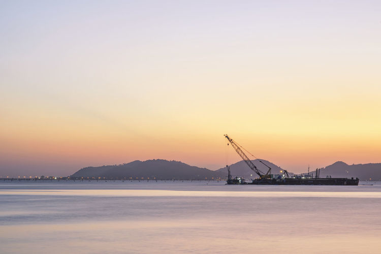 Architecture Beauty In Nature Crane - Construction Machinery Day Drilling Rig Nature Nautical Vessel No People Oil Pump Outdoors Peerawas Scenics Sea Silhouette Sky Sunset Tranquil Scene Tranquility Transportation Water Waterfront