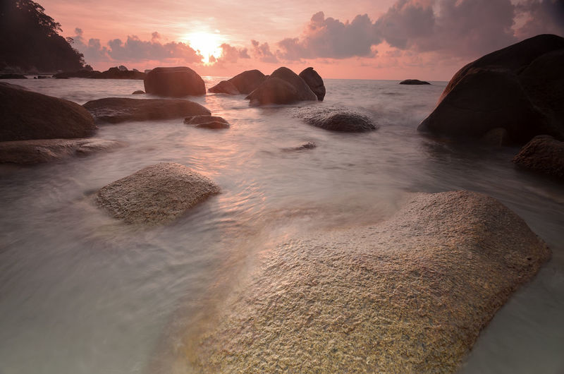 View Of Calm Beach At Sunset