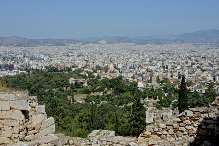 panoramic view of Athens town seen from the Acropolis Architecture Building Exterior City Built Structure Cityscape Residential District Sky Building Mountain Nature Town Day Crowded Travel Destinations History Clear Sky The Past Travel Outdoors TOWNSCAPE Ancient Civilization Stone Wall Athens Greece Athens City Athens Panorama Panoramic View Skyline Greek Archeological Archeology