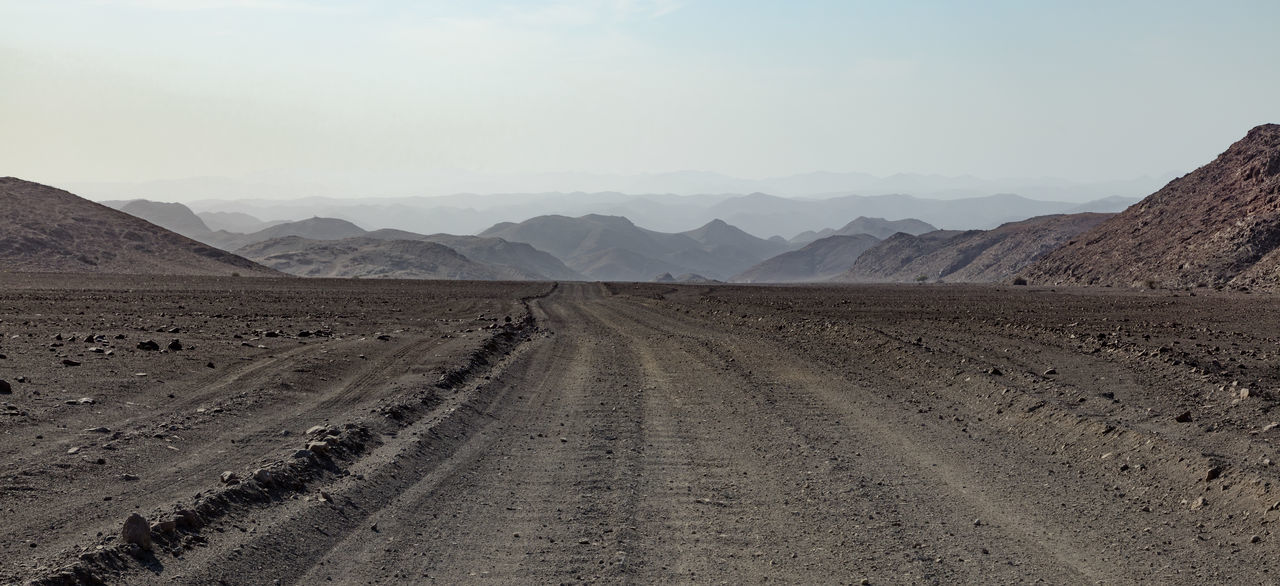 Dust Road in Kaokoland, a part of the Kunene Region in North East Namibia 4wd Track Beautiful Desert Holidays Kaokoland Namibia Nature Rocky Africa Desert Beauty Dry Dust Road Kaokoveld Kunene Landscape Mountain Outdoors Rural Scene Scenics Southern Africa Vacation