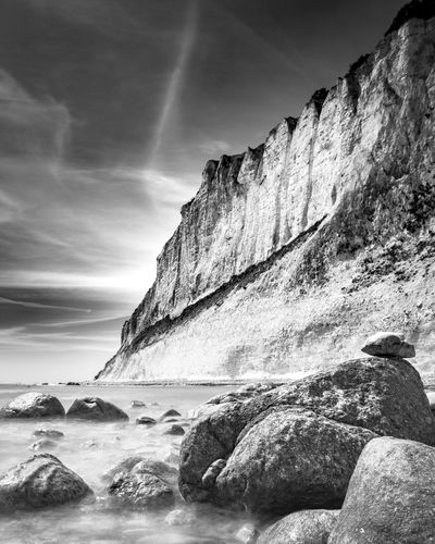 Epic coastline at Möns Klint, Denmark. Chalk Cliffs Denmark Beauty In Nature Cliff Day Dramatic Landscape Eroded Flowing Water Formation Island Møn Mountain Møns Klint Nature No People Rock Rock - Object Rock Formation Scenics - Nature Sea Sky Solid Sunlight Tranquil Scene Tranquility Water