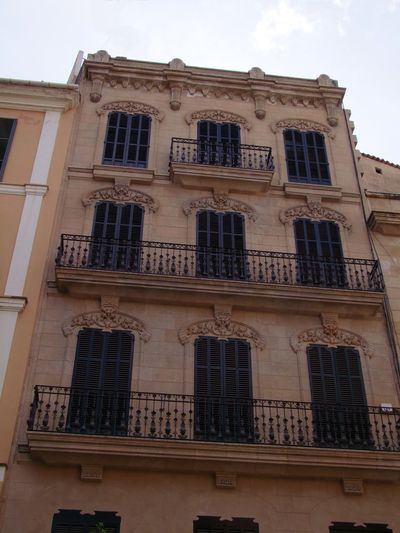 Traditional Ornate Balconies, Palma City Composition Mallorca Palma Palma De Mallorca SPAIN White Clouds Architectural Feature Architecture Balconies Building Exterior Building Facade Built Structure Capital City Looking Up Low Angle View No People Outdoor Photography Residential Building Traditional Building Windows Wrought Iron Design