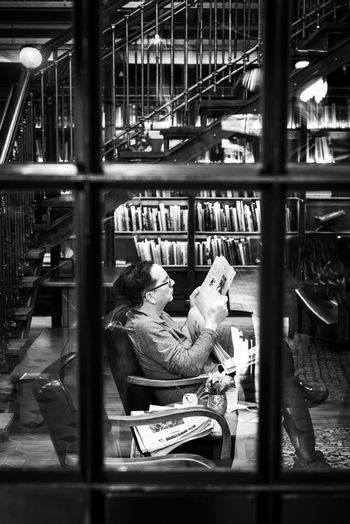 Man sitting on seat in library