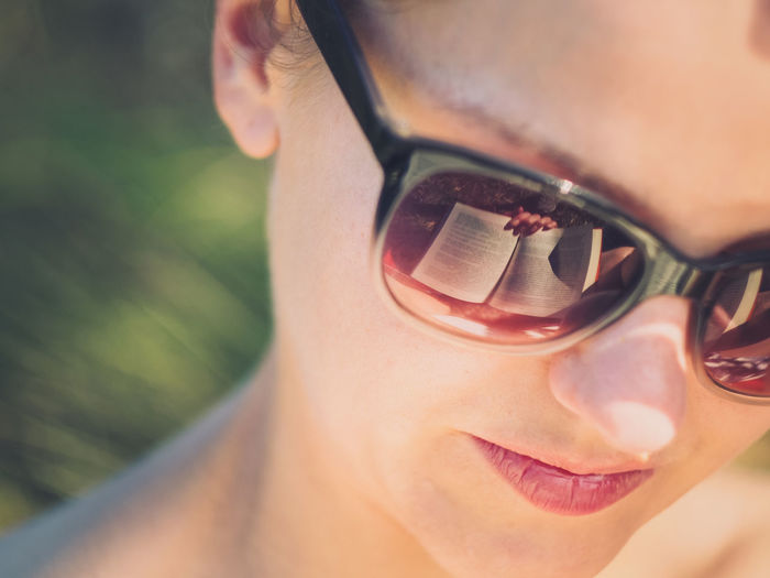Close-Up Of Smiling Woman Wearing Sunglasses