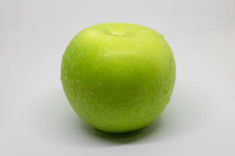 Close-up of apple against white background