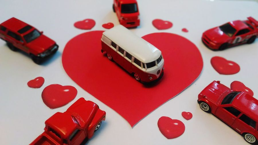Valentine's day Minicars Mini Cars Diecastphotography Symbiotic Relationship Love Yourself Conceptual Love Be Mine Red Indoors  Table Close-up No People Arts Culture And Entertainment White Background Love Yourself Still Life Indoors  High Angle View Gambling Focus On Foreground Toy Car Day