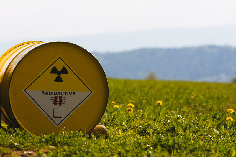 Atomic Radioactive Radioactive Catastrophy Beauty In Nature Close-up Communication Danger Dangerous Day Field Grass Growth Landscape Mountain Nature No People Outdoors Plant Radioactive Barrels Radioactivity Sky Text