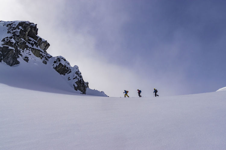 Ski Ski Touring Skier Skiers Skiing Backcountry Slope Powder Fresh Sky Winter Mountain Mountains Sunny Clear Cloud Clouds Mist Snow Leisure Activity Sport Lifestyles Adventure Winter Sport Snowcapped Mountain