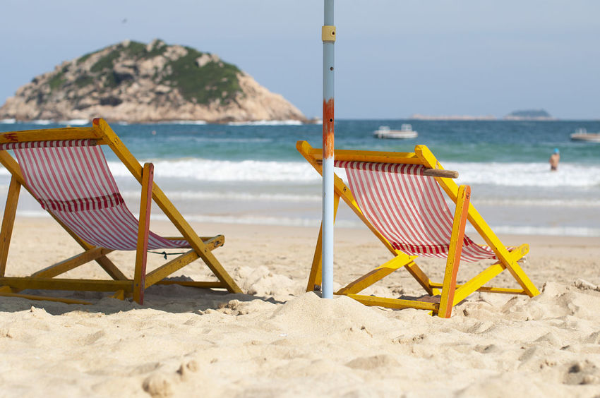 Shek O Shek O Absence Beach Beauty In Nature Chair Day Deck Chair Horizon Over Water Land Nature No People Outdoors Relaxation Sand Scenics - Nature Sea Seat Sky Striped Sunlight Tranquil Scene Tranquility Water