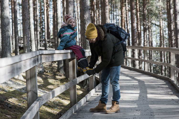 People standing on footbridge in winter