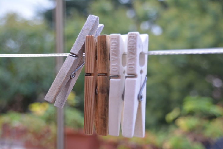 Close-Up Of Pegs On Washing Line Against Blurred Background
