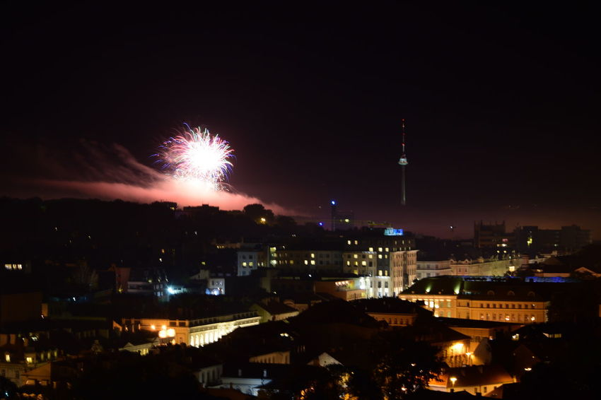 Vilnius Fireworks festival Celebration City City Life Cityscape Cloud - Sky Dark Entertainment Event Exploding Firework - Man Made Object Firework Display Glowing Illuminated Night No People Outdoors Sky Sparks Spire  Vilnius Fireworks Festival