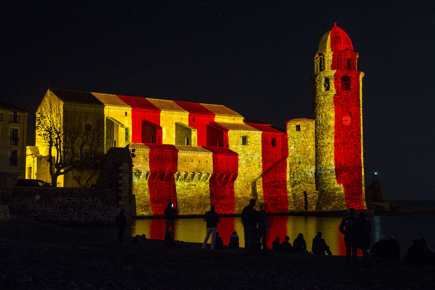 Architecture Building Exterior Built Structure Illuminated Large Group Of People Leisure Activity Lifestyles Mapping Festival Men Night Outdoors Real People Red Sky Text Travel Destinations Women Yellow