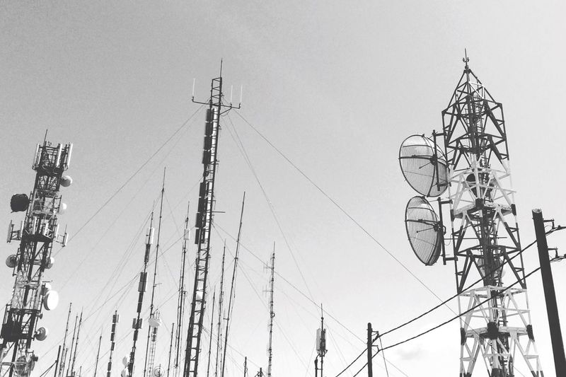Low angle view of communications towers