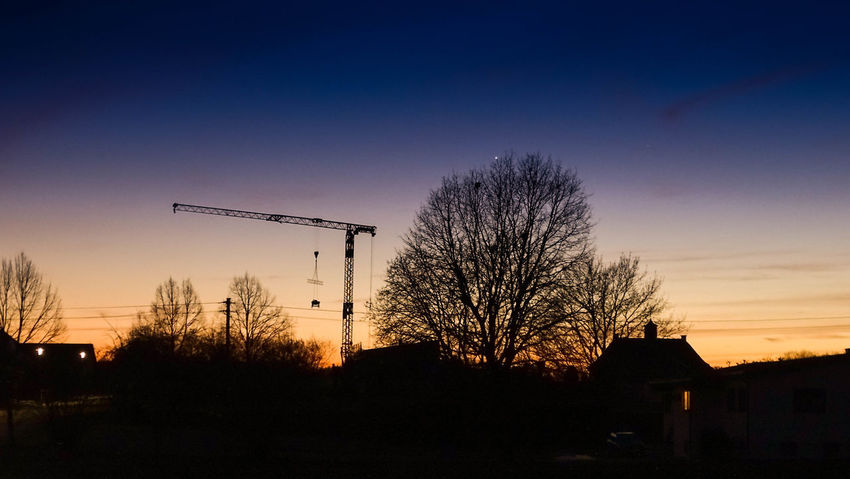 Architecture Bare Tree Building Exterior City Day Dusk Illuminated Nature No People Outdoors Road Sign Silhouette Sky Sunset Tree