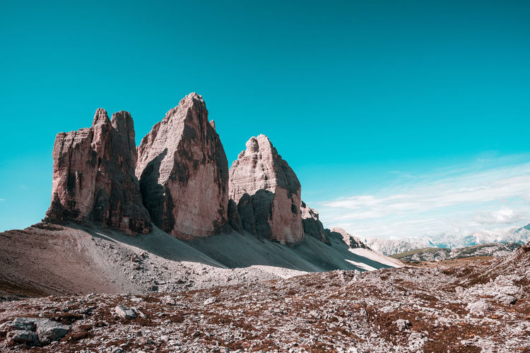 Panoramic view of rocks and mountain against blue sky