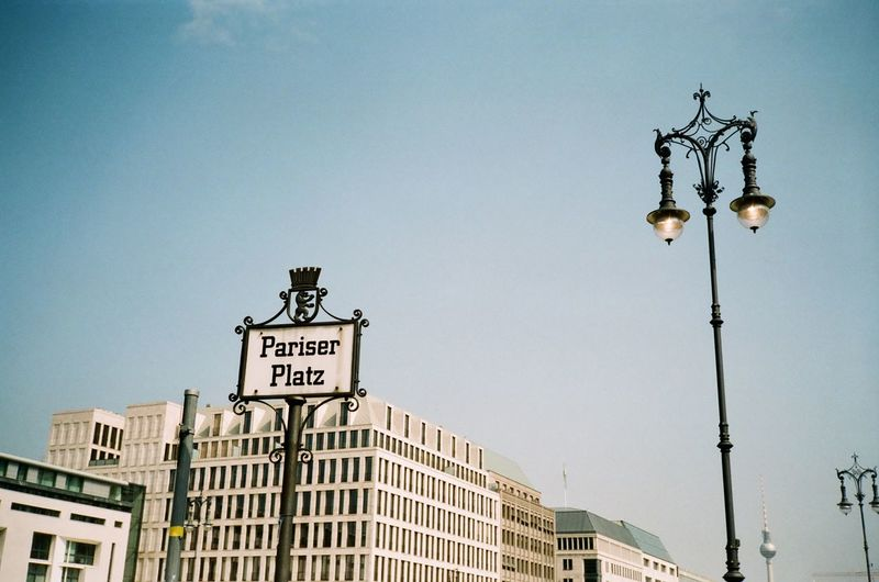 Low Angle View Of Pariser Platz Sign And Buildings Against Sky