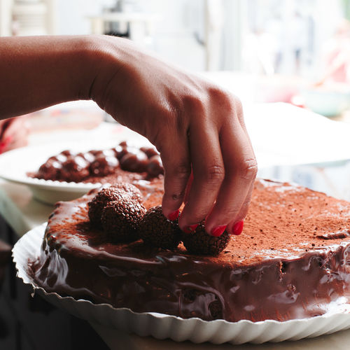 Baked Cake Chocolate Chocolate Cake Close-up Cupcake Holder Dessert Finger Focus On Foreground Food Food And Drink Freshness Hand Human Body Part Human Hand Indoors  Indulgence One Person Real People Sweet Sweet Food Temptation Unhealthy Eating