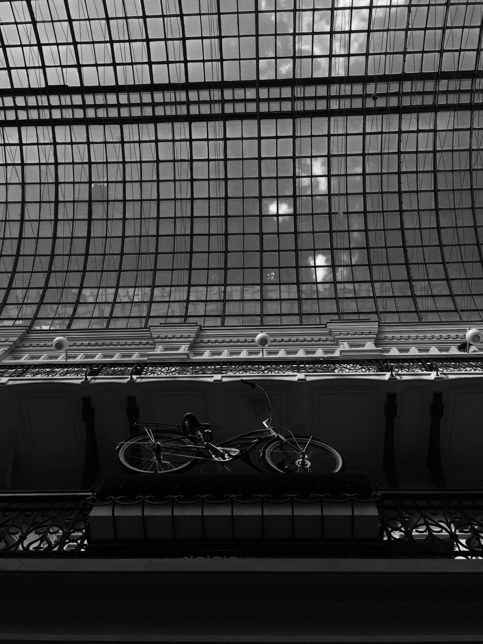 Side View Of Bicycle Parked Against Wall