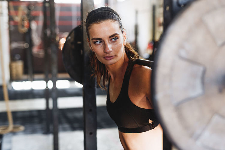 Athlete Exercising Motivation Sport Club Woman Young Caucasian Crossfit Fitness Healthy Lifestyle Indoors  One Person Real People Training Weightlifting