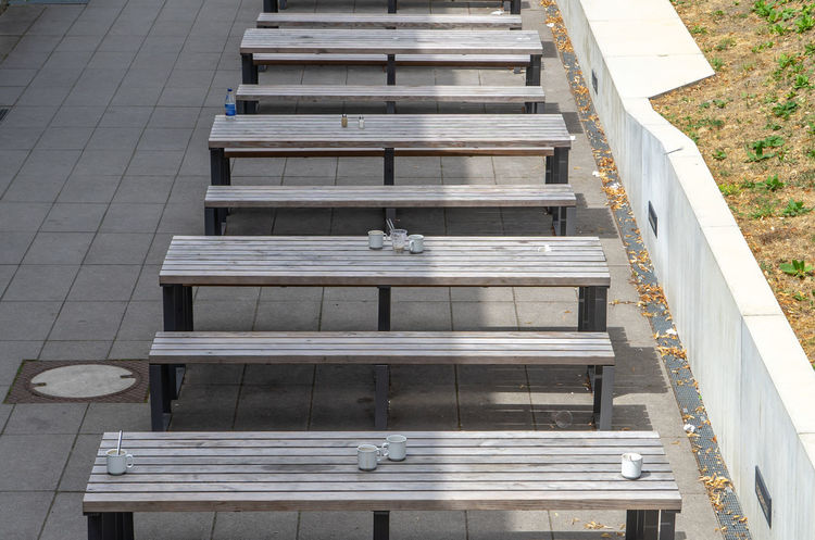 Architecture Built Structure City Day Direction High Angle View In A Row No People Outdoors Pattern Railing Seat Sunlight Sunlight And Shadow Table Table And Bench The Way Forward Wood - Material