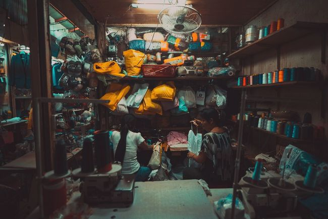 On this episode of How It's Made... Indoors  Real People Multi Colored Travel Destinations Cambodia Travel Photography Real Life Market Market Stall Showcase: April For Sale ASIA Travel Culture People Lifestyles Labor Reality The Street Photographer - 2017 EyeEm Awards