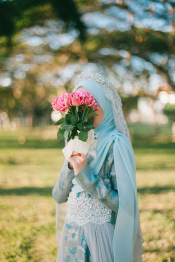 girl holding flowers Beauty In Nature Blue Blue Dress Bokeh Bokeh Photography Flower Flower Collection Flower Head Flower Photography Flowerporn Hijab Hijabfashion Rose - Flower Roses Water Wedding Wedding Day Wedding Dress Wedding Photography Weddings Around The World Weekend
