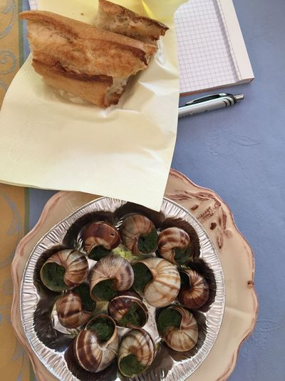 Escargots with baguette Baguette Escargot Close-up Day Food Food And Drink French French Food Freshness High Angle View Indoors  No People Plate Ready-to-eat Serving Size Snails Table