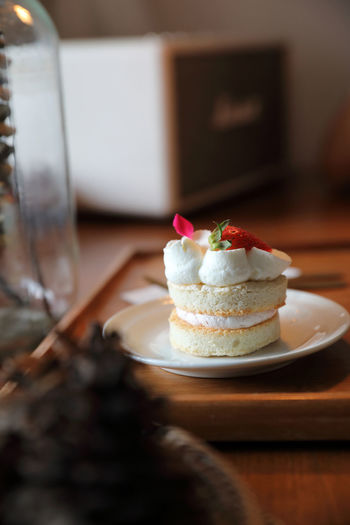 Close-up of cake served on table