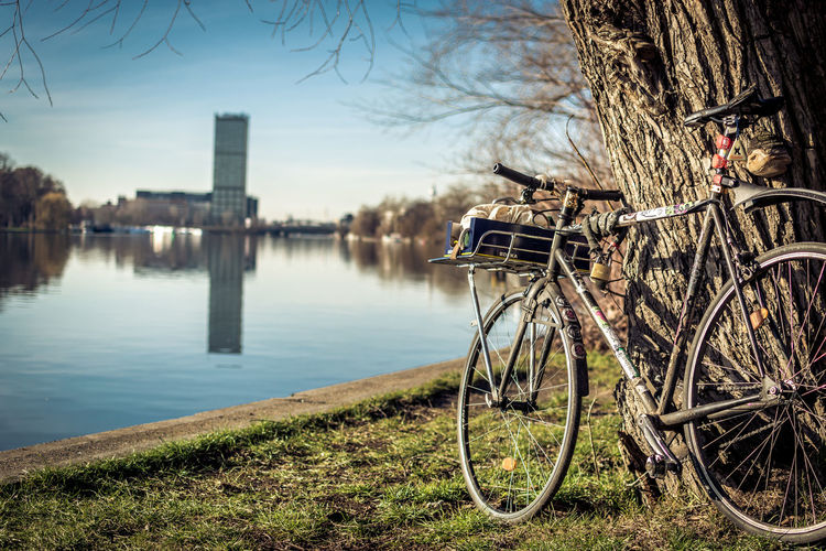 Nature No People Day Outdoors Water Bicycle Tree Transportation Plant Mode Of Transportation Architecture Land Vehicle Lake Sky Building Exterior Built Structure Bare Tree City Wheel