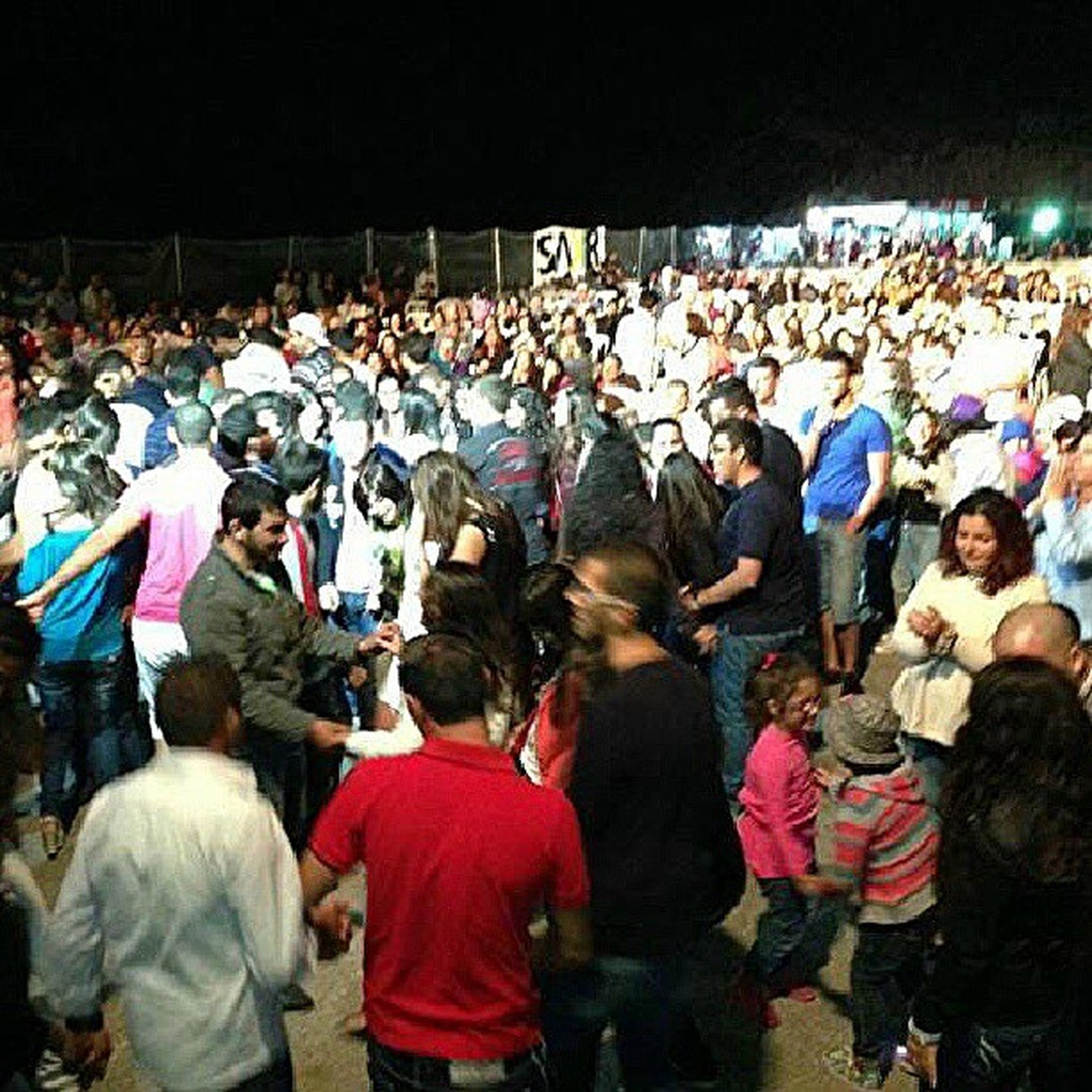large group of people, crowd, lifestyles, men, person, spectator, leisure activity, enjoyment, togetherness, performance, arts culture and entertainment, event, fun, celebration, casual clothing, music, mixed age range, illuminated