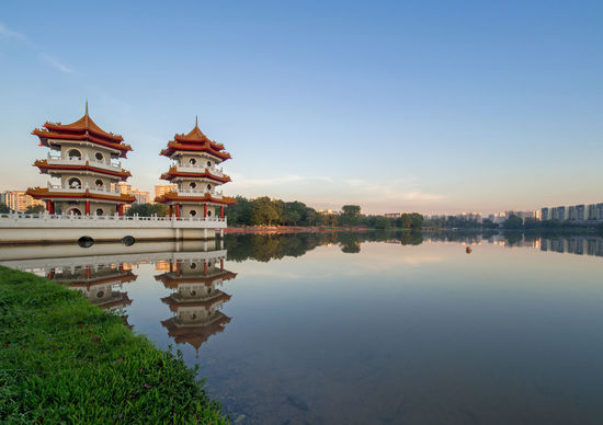 Pagoda Twins Pagoda Reflection Singapore Architecture Building Exterior Built Structure Chinese Garden Clear Sky Day Nature No People Outdoors Religion Sky Sunrise Sunset Travel Destinations Tree Water