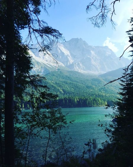 View of calm lake against mountain range