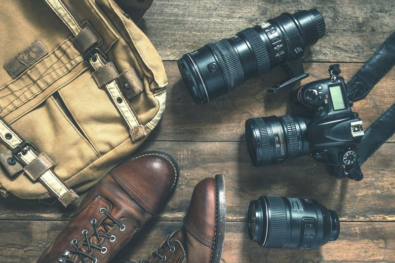 cameras and Lens and photography equipment Photography Vintage Lens Camera Still Life High Angle View Indoors  Table No People Close-up Black Color Bag Technology Fashion Equipment Wood - Material