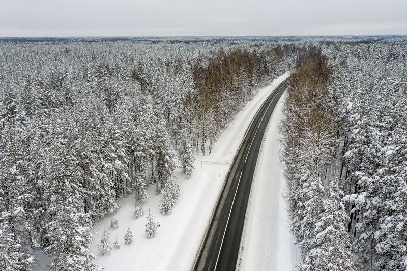Panoramic view of snow covered road against sky