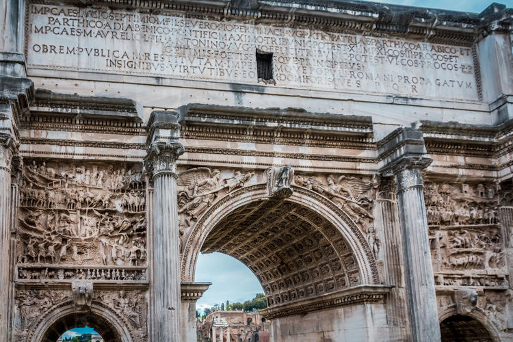 Architecture Arch Built Structure History The Past Tourism Building Exterior Travel Travel Destinations City Low Angle View Triumphal Arch Day Monument Craft Ancient Old No People Text Outdoors Architectural Column Carving Ancient Civilization Archaeology