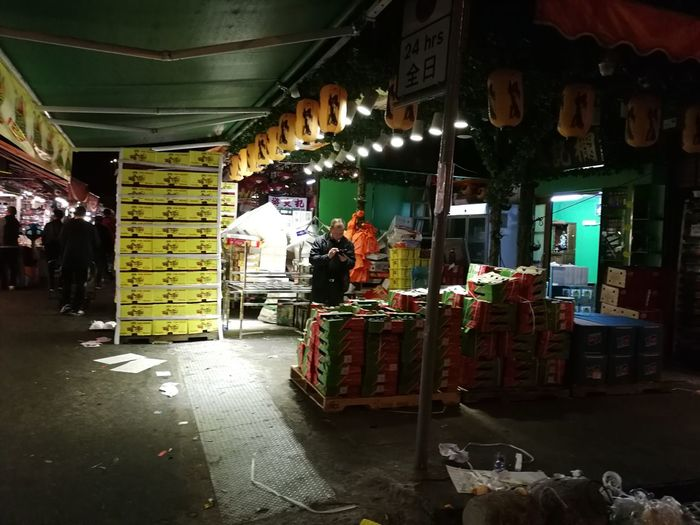 night at the fruit market Fruit Market Market Fruit Delivery Fruits In Boxes Stall Market Stall Farmer Market Market Vendor Street Market Stories From The City